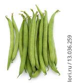 Купить «Green beans handful isolated on white background cutout», фото № 13036259, снято 10 апреля 2014 г. (c) Natalja Stotika / Фотобанк Лори