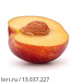 Купить «Nectarine fruit half isolated on white background close up», фото № 13037227, снято 6 июля 2015 г. (c) Natalja Stotika / Фотобанк Лори
