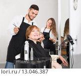 Купить «Barber makes the cut for woman», фото № 13046387, снято 9 июля 2020 г. (c) Яков Филимонов / Фотобанк Лори