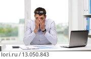 Купить «busy businessman with laptop and papers in office», видеоролик № 13050843, снято 9 июля 2015 г. (c) Syda Productions / Фотобанк Лори