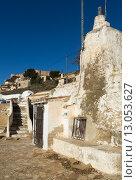Купить «Dwellings caves with сhimneys into mount. Chinchilla», фото № 13053627, снято 8 декабря 2014 г. (c) Яков Филимонов / Фотобанк Лори