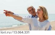 Купить «Elderly senior with mature woman at seashore vacation», фото № 13064331, снято 10 апреля 2014 г. (c) Яков Филимонов / Фотобанк Лори