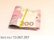 Купить «Пачка украинских денег, купюры 200 гривен», фото № 13067307, снято 15 ноября 2015 г. (c) Ивашков Александр / Фотобанк Лори