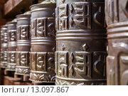 Купить «Фрагмент тибетских молитвенных барабанов», фото № 13097867, снято 9 мая 2015 г. (c) Оксана Гильман / Фотобанк Лори