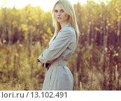 Купить «Portrait of young beautiful woman in autumn cloak», фото № 13102491, снято 28 сентября 2015 г. (c) Ingram Publishing / Фотобанк Лори