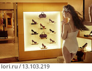 Купить «Fashion woman looking at high-heel shoes», фото № 13103219, снято 15 сентября 2012 г. (c) Ingram Publishing / Фотобанк Лори