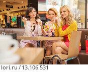 Купить «Portrait of the young girlfriends eating ice cream», фото № 13106531, снято 9 марта 2014 г. (c) Ingram Publishing / Фотобанк Лори