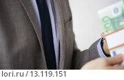 Купить «close up of businessman taking money bribe», видеоролик № 13119151, снято 12 апреля 2015 г. (c) Syda Productions / Фотобанк Лори