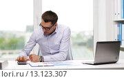 Купить «busy businessman with laptop and papers in office», видеоролик № 13123307, снято 9 июля 2015 г. (c) Syda Productions / Фотобанк Лори