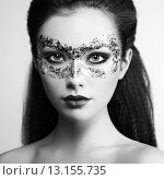 Купить «Beautiful young woman in gold mysterious mask», фото № 13155735, снято 28 октября 2014 г. (c) Ingram Publishing / Фотобанк Лори