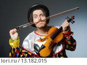 Купить «Funny violin clown player in musical concept», фото № 13182015, снято 16 сентября 2015 г. (c) Elnur / Фотобанк Лори