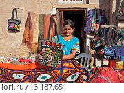Купить «Street vendors near Islam-Khodja Madrasah, Khiva, Uzbekistan», фото № 13187651, снято 23 мая 2018 г. (c) age Fotostock / Фотобанк Лори