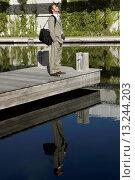 Купить «Businessman Standing on Dock», фото № 13244203, снято 25 января 2020 г. (c) age Fotostock / Фотобанк Лори
