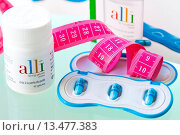 Купить «Alli is a half_dose version of the diet drug Xenical Orlistat produced by GlaxoSmithKline GSK. First anti_obesity drug, available in pharmacy without prescription in France from May 6 2009.», фото № 13477383, снято 6 мая 2009 г. (c) age Fotostock / Фотобанк Лори