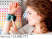 Купить «Woman taking her blood pressure with a portable blood pressure monitor.», фото № 13488771, снято 14 июня 2018 г. (c) age Fotostock / Фотобанк Лори