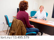 Купить «Cancer radiotherapist with a female patient suffering from throat cancer in consultation for medical follow after radiotherapy treatment. Radiotherapy...», фото № 13495579, снято 14 декабря 2017 г. (c) age Fotostock / Фотобанк Лори