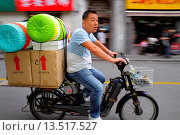 Купить «China, Shanghai, Huangpu District, Sichuan Road, Asian, man, electric motor scooter bike, bicycle, moped, riding, no helmet, motion, boxes, baskets, Mandarin symbols, hanzi,», фото № 13517527, снято 25 мая 2019 г. (c) age Fotostock / Фотобанк Лори