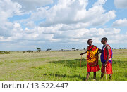 Купить «Kenya Masai Mara reserve with space and two Masai warriors and clouds in Masai Mara National Park in reserve 8», фото № 13522447, снято 7 июня 2020 г. (c) age Fotostock / Фотобанк Лори