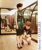 Купить «Fashion designer, Lu Kun fitting a traditional qipao inspired modern dress on a model», фото № 13529263, снято 13 ноября 2018 г. (c) age Fotostock / Фотобанк Лори