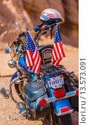 Купить «A Harley-Davidson motorcycle parked along the Camino del Rio along the Rio Grande River, which is the border of the USA and Mexico, Big Bend Ranch State Park, Texas USA», фото № 13573091, снято 23 июня 2018 г. (c) age Fotostock / Фотобанк Лори