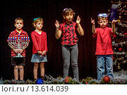Купить «Deaf Jewish children act out a skit in sign language during a Christmas/Hanukah pageant at the California School for the Deaf in Riverside, CA. Note menorah.», фото № 13614039, снято 21 июля 2018 г. (c) age Fotostock / Фотобанк Лори