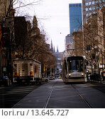 Купить «Electric tram on winter morning, Bourke Street, Melbourne, Victoria, Australia», фото № 13645727, снято 23 января 2020 г. (c) age Fotostock / Фотобанк Лори