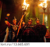 Купить «Viking warriors lead the torchlight procession through the streets of Edinburgh to start Edinburgh´s hogmanay celebrations», фото № 13665691, снято 23 апреля 2019 г. (c) age Fotostock / Фотобанк Лори