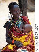 Купить «Kenya, Samburu Tribe Woman Holding Her Baby Close To Her With Colorful Fabric Sling; Samburu National Reserve», фото № 13771667, снято 15 ноября 2019 г. (c) age Fotostock / Фотобанк Лори