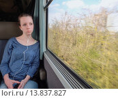 Купить «Teen ager in a train listening to music.», фото № 13837827, снято 22 августа 2018 г. (c) age Fotostock / Фотобанк Лори