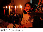 Купить «A family is lighting a candle for the Jewish holiday of Hanukkah.», фото № 13930719, снято 30 ноября 2007 г. (c) age Fotostock / Фотобанк Лори