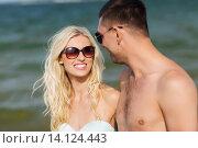 Купить «happy couple in swimwear walking on summer beach», фото № 14124443, снято 11 августа 2015 г. (c) Syda Productions / Фотобанк Лори