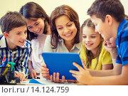 Купить «group of kids with teacher and tablet pc at school», фото № 14124759, снято 15 ноября 2014 г. (c) Syda Productions / Фотобанк Лори