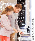 Купить «happy couple choosing engagement ring in mall», фото № 14124943, снято 10 ноября 2014 г. (c) Syda Productions / Фотобанк Лори