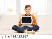 Купить «smiling boy with tablet computer at home», фото № 14125987, снято 24 октября 2015 г. (c) Syda Productions / Фотобанк Лори