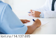 Купить «close up of doctor taking notes at hospital», фото № 14137695, снято 14 марта 2015 г. (c) Syda Productions / Фотобанк Лори