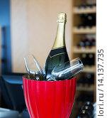 Купить «close up of champagne and glasses at restaurant», фото № 14137735, снято 30 апреля 2015 г. (c) Syda Productions / Фотобанк Лори