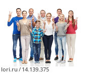 Купить «group of smiling people showing peace hand sign», фото № 14139375, снято 21 октября 2015 г. (c) Syda Productions / Фотобанк Лори