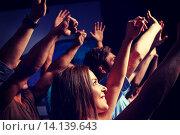 Купить «smiling friends at concert in club», фото № 14139643, снято 20 октября 2014 г. (c) Syda Productions / Фотобанк Лори