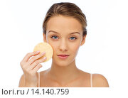 Купить «young woman cleaning face with exfoliating sponge», фото № 14140759, снято 31 октября 2015 г. (c) Syda Productions / Фотобанк Лори