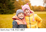 Купить «happy little girl and boy in autumn park», фото № 14157487, снято 10 октября 2015 г. (c) Syda Productions / Фотобанк Лори