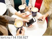 Купить «close up of hands with coffee cups and smartphones», фото № 14158927, снято 3 ноября 2014 г. (c) Syda Productions / Фотобанк Лори
