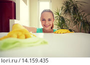 Купить «happy woman cleaning table at home kitchen», фото № 14159435, снято 25 января 2015 г. (c) Syda Productions / Фотобанк Лори