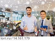Купить «happy man showing thumbs up in auto show or salon», фото № 14161179, снято 22 января 2015 г. (c) Syda Productions / Фотобанк Лори