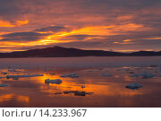 Купить «Russia , Chukotka autonomous district , Wrangel island , Pack ice at sunset.», фото № 14233967, снято 16 июля 2018 г. (c) age Fotostock / Фотобанк Лори