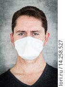 Купить «Man wearing a face mask to protect himself from MERS-CoV.», фото № 14258527, снято 6 июня 2013 г. (c) age Fotostock / Фотобанк Лори