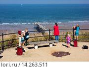 Купить «Children looking through telescopes at Saltburn by the Sea, North Yorkshire, England, United Kingdom.», фото № 14263511, снято 27 мая 2019 г. (c) age Fotostock / Фотобанк Лори