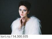 Купить «Студийный портрет брюнетки с короткими волосами», фото № 14300935, снято 25 ноября 2015 г. (c) Инга Макеева / Фотобанк Лори