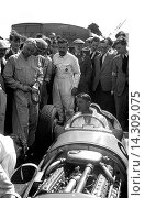 Купить «Mechanic Ken Richardson warms-up the BRM V16 on public debut with driver Raymond Sommer, competing in the International Trophy, Silverstone, England, 1950.», фото № 14309075, снято 23 июля 2013 г. (c) age Fotostock / Фотобанк Лори