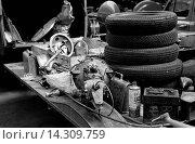 Купить «Spare tyres behind the pits, race preparation for the Dundrod TT, Northern Ireland,1953.», фото № 14309759, снято 23 июля 2013 г. (c) age Fotostock / Фотобанк Лори