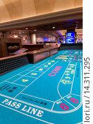 Купить «Craps Table - Casino Interior, Harrah's Hotel and Casino, Las Vegas, Nevada, USA. Without dices.», фото № 14311295, снято 15 октября 2013 г. (c) age Fotostock / Фотобанк Лори